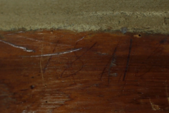 The date 1811 carved into the log wall